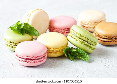 French assorted macarons on light gray concrete background. Food concept with copy space.