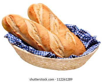 French baguette bread, freshly baked whole loaves on blue gingham check cloth in basket. Isolated on white.