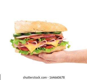 French baguette sandwich in hand. Isolated on a white background.