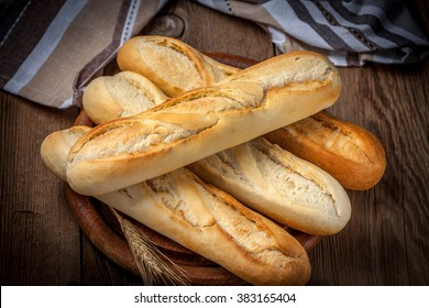 French baguettes on old wooden table. Selective focus.