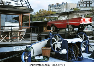 french barge in Paris with amphibious car