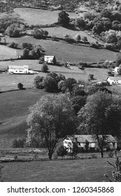 French Basque Country landscape with farm houses at background. France. Black and white photo.