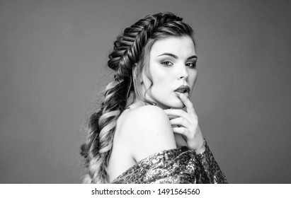 French braid. Professional hair care and creating hairstyle. Braided hairstyle. Beautiful young woman with modern hairstyle. Beauty salon hairdresser art. Girl makeup face braided long hair.