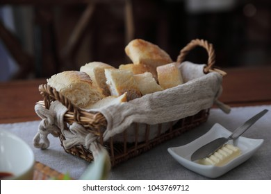 French bread baguettes in wood basket the wooden background