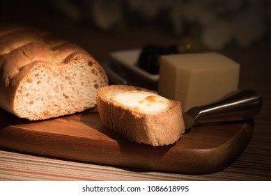 French bread with mozzarella cheese and olive bowl