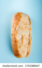 French bread roll isolated on light blue background.