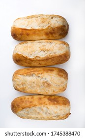 French bread rolls in a row isolated on light background.