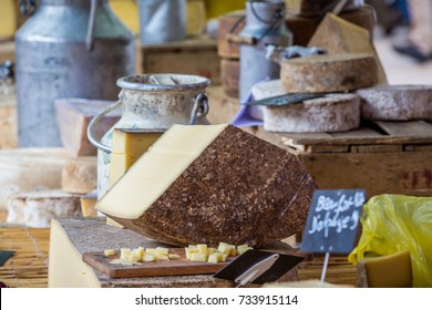 French cheese market stall in Beaune, Burgundy, France in June 2016
