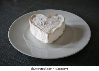 A French cheese in a shape of a heart on a plate