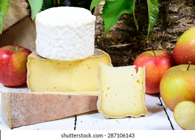 french cheeses with apples in the background