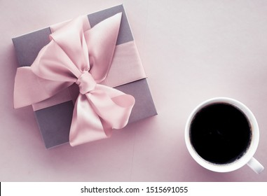 French chic, Valentines Day present and beauty drink concept - Luxury gift box and coffee cup on blush pink background, flatlay design for romantic holiday and birthday surprise