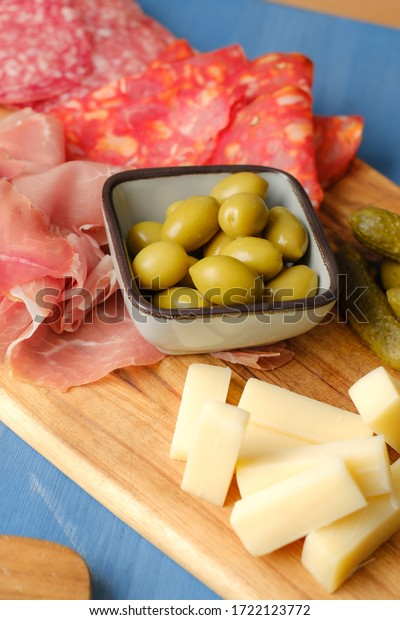 French cold cuts on plate with olives salami