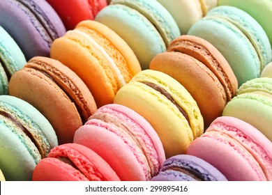 French colorful macarons background, close up