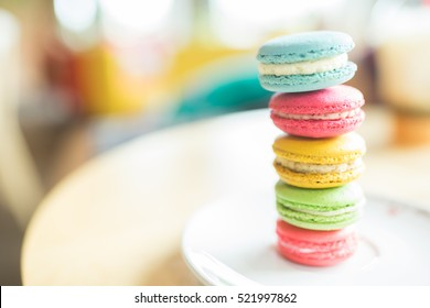 French colorful macarons background,Colorful macarons on vintage pastel background. Macaron or Macaroon is sweet meringue-based confection.