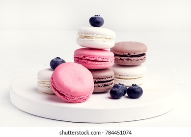 French Colorful Macarons Colorful Pastel Macarons on White Background Whitr Pink and Brown Macaron with Fresh Blueberry