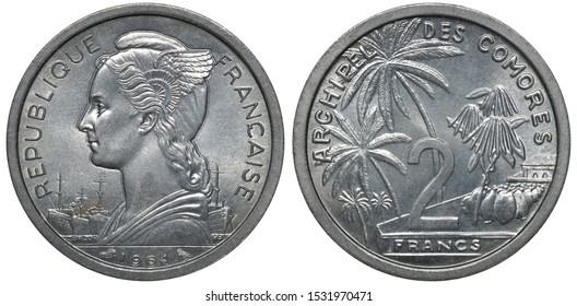 French Comoro Islands aluminum coin 2 two francs 1964, bust of Liberty left, small merchant ships below, denomination among palm trees and fruits,