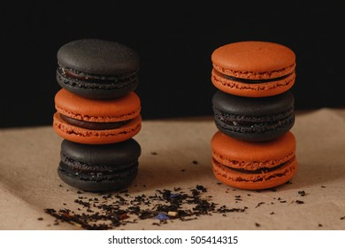 french cookies black and orange macaroons on a  background Halloween