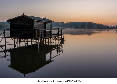 French countryside - Lorraine. A small lake with fisherman's hut at sunrise.