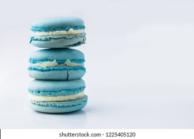 French crash macarons. Stack of blue macaron with dorblu and wine isolated on white background. Colorful macaroons. Top view