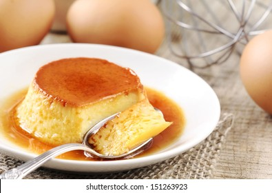 French creme caramel dessert or flan with ingredients at the background