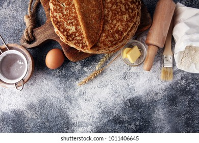 French crepes or pancakes with ingredient on grey background