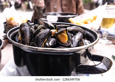 French cuisine - Moules frite aka mussels and fries or chips. A classic dish in Belgium and France.