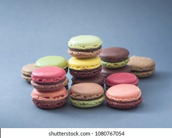 French cuisine pastry macaron variations and colours with an unsaturated blue background
