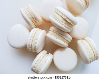 French dessert macaron with vanilla and white chocolate ganache on a white background