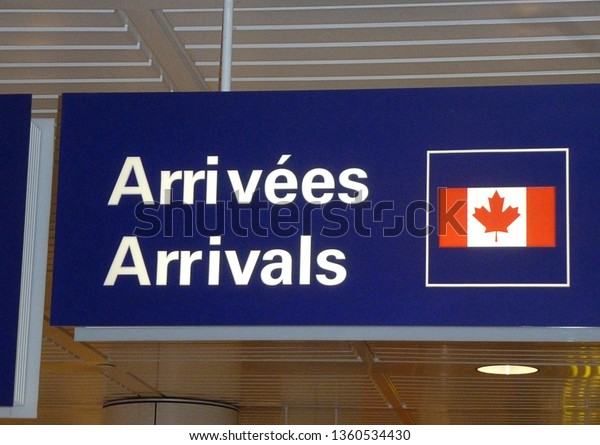 French and English bilingual sign depicting arrivals at Canadian airport