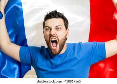 French fan celebrating holding the flag of France