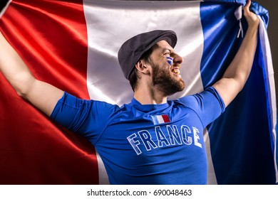 French fan holding the national flag