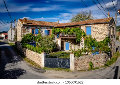 French Farmhouse with Blue shutters