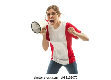 French female fan celebrating on white background. The young woman in soccer football uniform as winner with megaphone isolated at white studio. Fan, support concept. Human emotions concept.