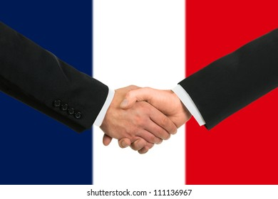 The French flag and business handshake