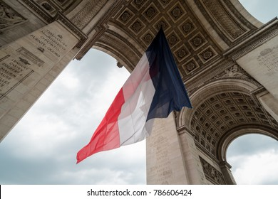 french flag during bastille day in paris at Arc de Triomphe