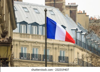 French flag  front of building in Paris