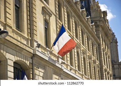 French flag hanging from a base of a window