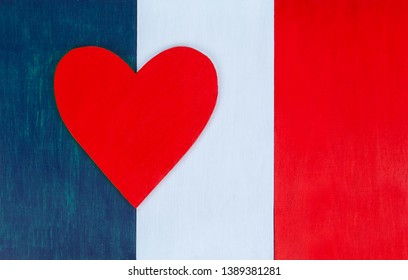 French flag and heart, love for France, Paris & French culture - painted wooden background for rustic, vintage and authentic styles - tricolor of the nation of France.