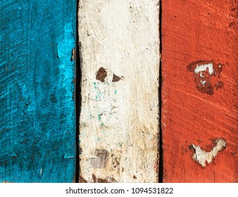 French flag made of painted wood planks. Grungy texture or background.