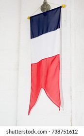 French flag near a wood wall outdoors