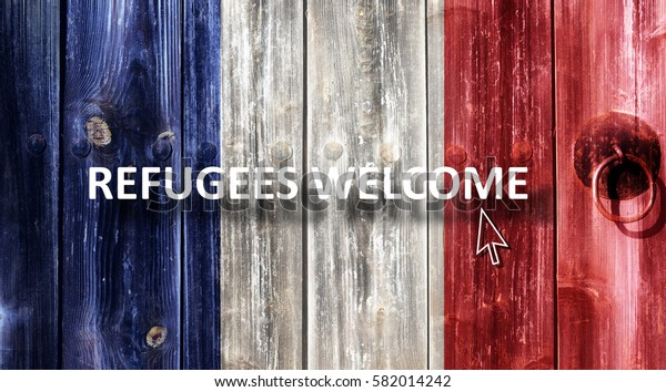 French flag painted on an old wooden door. Next to the door handle text Refugees Welcome