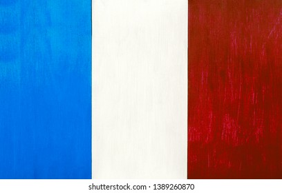 French flag as a painted wooden background, for rustic, vintage and authentic styles - pastel paint on wood for the country of France.