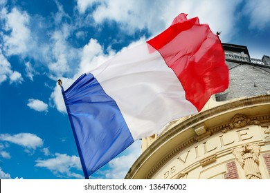 French flag waving over one Hotel de Ville