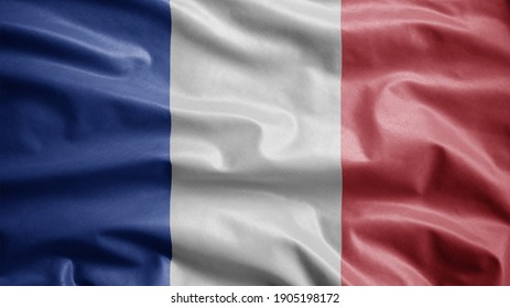 French flag waving in the wind. Close up of France banner blowing, soft and smooth silk. Cloth fabric texture ensign background. Use it for national day and country occasions concept.