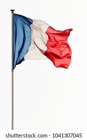 French flag waving in the wind on a pole against a white background