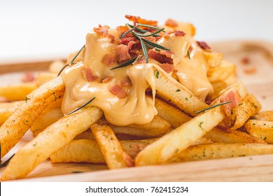 French Fried Melted Cheddar Cheese with Crispy Bacon and Rosemary on Wooden Plate, White Background, Close Up