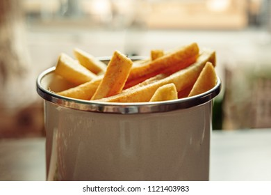 French fries in basket served in cafe angle from above view.