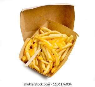 French fries box, fried potatoes french fries with yellow cheese or sauce in brown box isolated white background top view with clipping path.