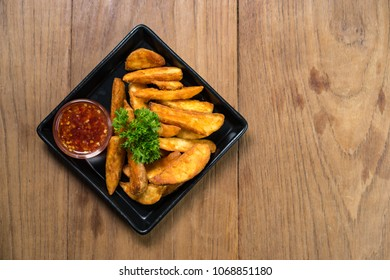 French fries, chips, finger chips are cut deep-fried potatoes,Common fast food served with tomato sauce, ketchup, vinegar, mayonnaise