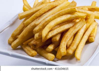 French fries close up on a white dish